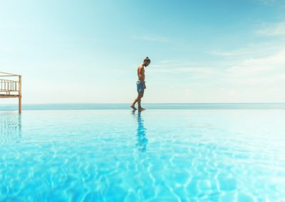Man Standing on Infinity Pool