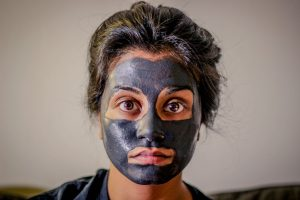 Woman Wearing Charcoal Mud Mask